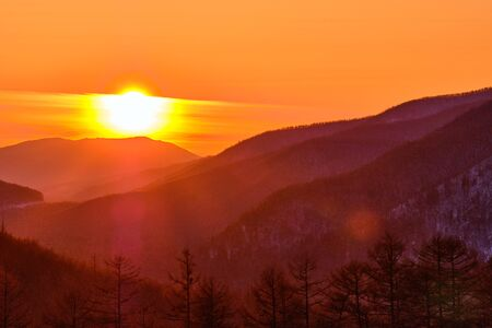 Sunset among the mountains on the road Lidoga-Vanino Khabarovsk territory