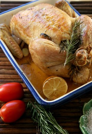 Roasted Chicken and Sea Salt served with fresh lemon Stock Photo - 2297627
