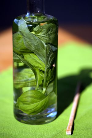 Basil in a bottle infusing spring water for cooking Stock Photo