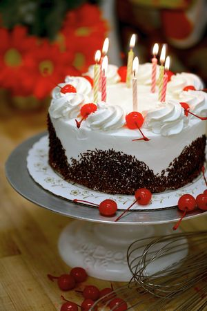 epicurean: Birthday cake with lit candles