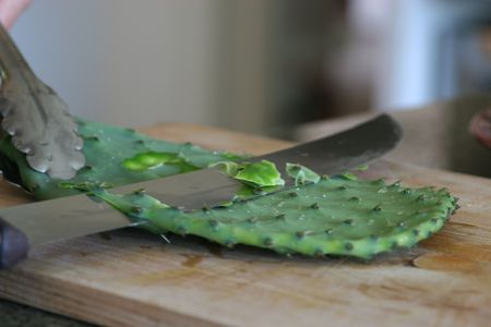 Nopales cactus paddles being prepped for cooking