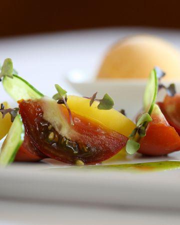Heirloom tomato salad with micro greens Stock Photo