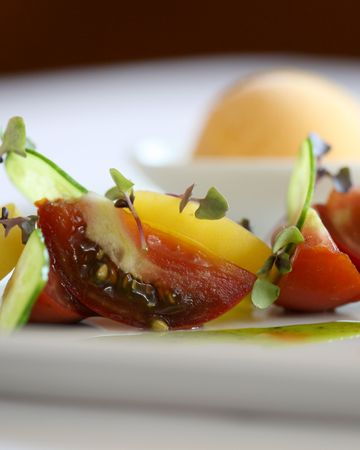 Heirloom tomato salad with micro greens Stock Photo