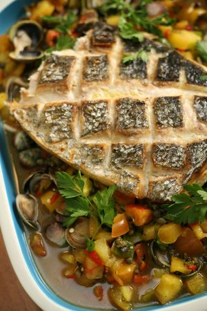 epicurean: Baked Halibut with clams served on a bed of vegetables