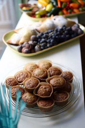 Freshly baked muffins and fruit plates at a buffet Stock Photo