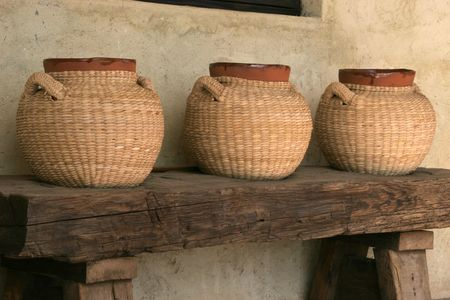 Wicker encased terra cotta jugs at a Vineyard in the Valle de Guadalupe