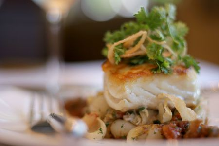 Fresh sauteed sea bass on bed of roasted vegetables Banco de Imagens