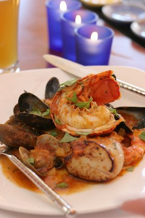 Grilled lobster and scallops with beer photo