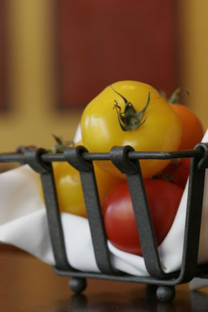Basket of fresh tomatoes photo