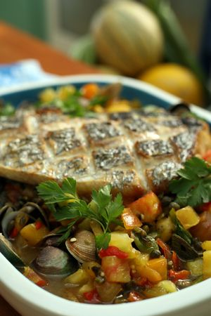 Baked Seabass served with fresh vegetable ragout photo