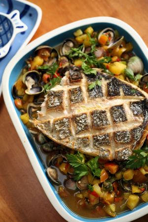 Roasted sea bass with vegetable and shellfish ragout