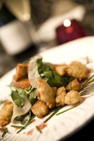 Fried Malpeque Oysters served with  arugula, shaved fennel, blood orange vinaigrette, and cumin scented croutons Stock Photo