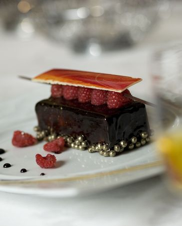 epicurean: Dark chocolate tart with raspberry wafer and gold chocolate caviar pearls