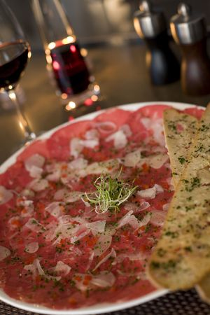 seasoned: A platter of beef carpaccio and shaved parmesan cheese with red wine