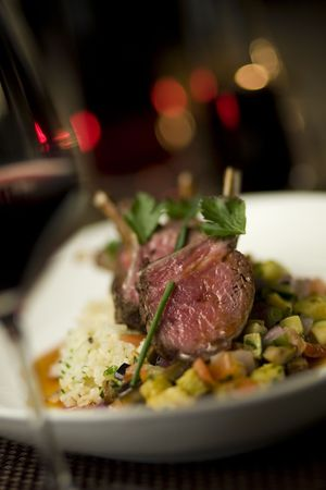 Rack of lamb on a bed of vegetable ragout