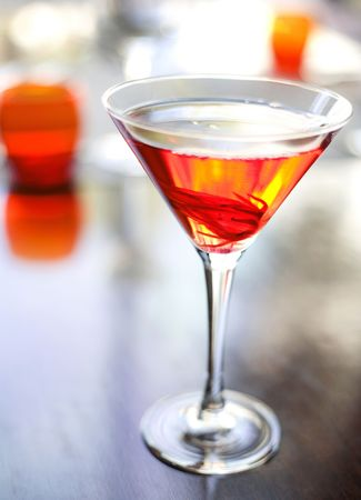 martini: The martini reincarnated with hibiscus syrup and candied blossom