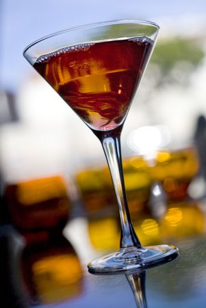 The martini reincarnated with hibiscus syrup and candied blossom Stock Photo - 4737129