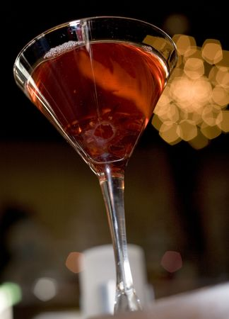 The martini reincarnated with hibiscus syrup and candied blossom