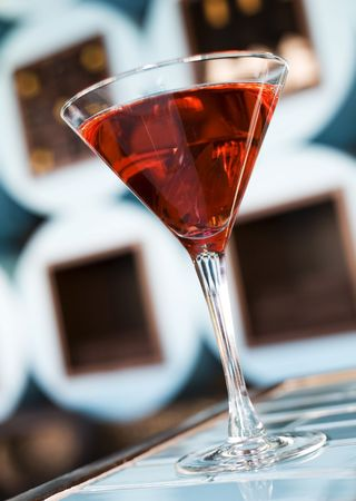 bar ware: The martini reincarnated with hibiscus syrup and candied blossom