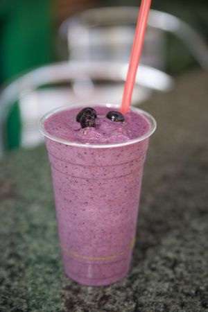 acai: Fresh fruit smoothies topped with whipped cream and blueberries