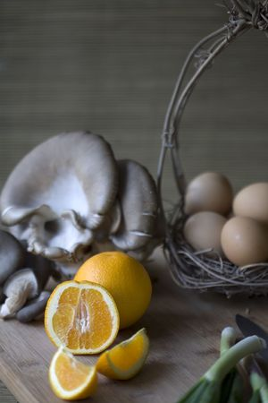 Fresh organic vegetables, eggs, and citrus on a chopping block Stock Photo - 4815954