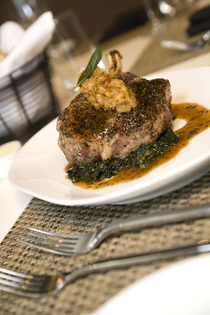 Braised leg of lamb served on bed of chopped spinach and au jus.