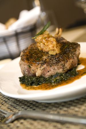 jus: Braised leg of lamb served on bed of chopped spinach and au jus.