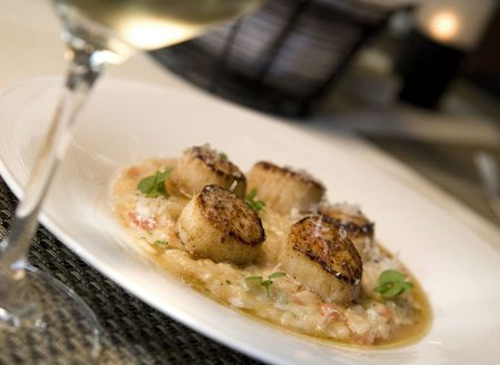 Seared sea scallops on a bed of risotto