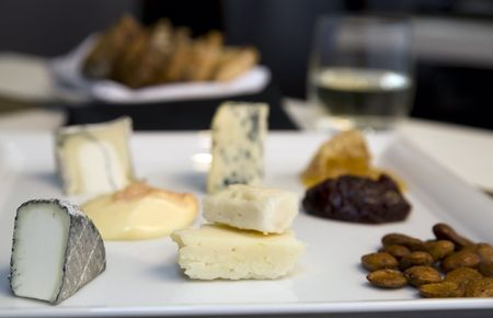 A sampler plate of fine cheeses, chutneys, and smoked nuts. Stock Photo - 5186697