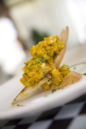Pumpking bruschetta garnished with fresh parsley on toast points Stock Photo