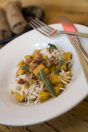 Pumpking Gnocchi with Pancetta and Sage Stock Photo
