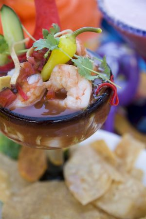 Classic Mexican shrimp cocktail with avocado and fresh tortilla chips.