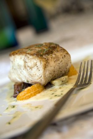 Broiled sea bass with citrus and beets served with white wine