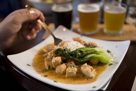 Chicken and coconut curry with sauteed bok choy and jasmine rice Stock Photo
