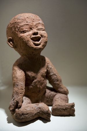 Baby Buddha sculpture made in rough clay.