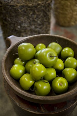 Plastic green apples in a decorative bowl Stock Photo