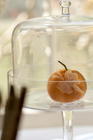 Vintage cut glass cake dish with a tangerine Stock Photo - 12421234