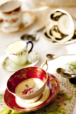 high tea: Antique fine bone china tea cups and saucers Stock Photo