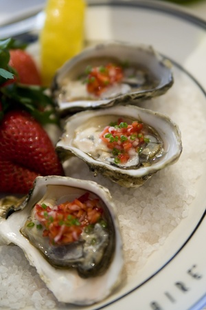 Endless Summer Oysters on ice dressed with strawberry mignonette