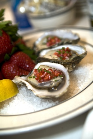 Endless Summer Oysters on ice dressed with strawberry mignonette Stock Photo - 12746001