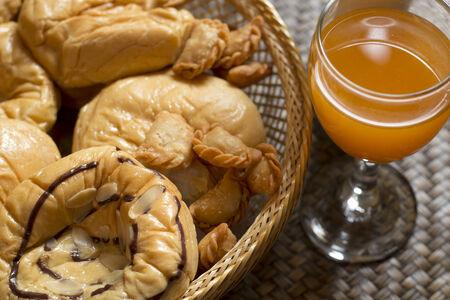 Orange Juice and bakery on bamboo background photo