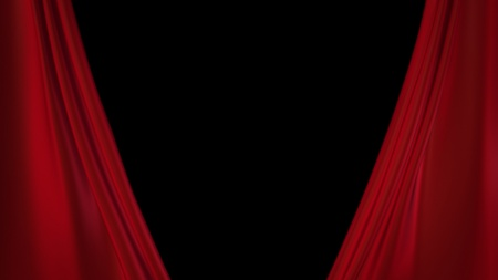 red curtains opening for the theatre   photo