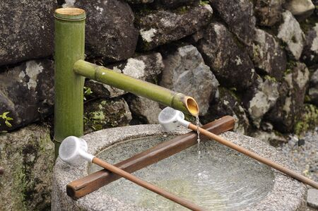 godliness: the fresh water in japanese well presenting the health Stock Photo