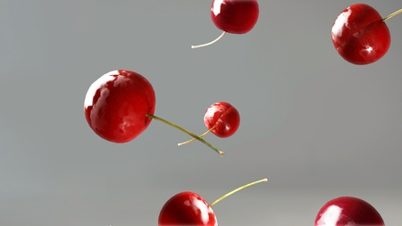 fresh cherries falling down for background use photo