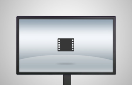 movie icon is showing on the monitor display, it is representing the selection of entertainment application photo