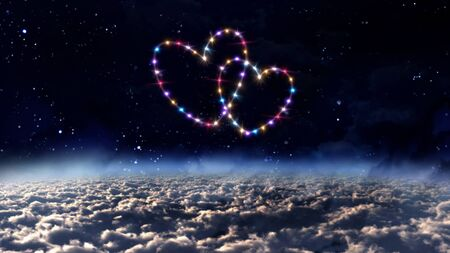 twinkles: starry night in space background with heart forming from stars Stock Photo