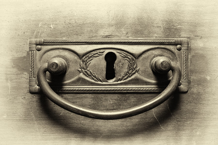 furniture hardware: Old drawer handle in sepia tone