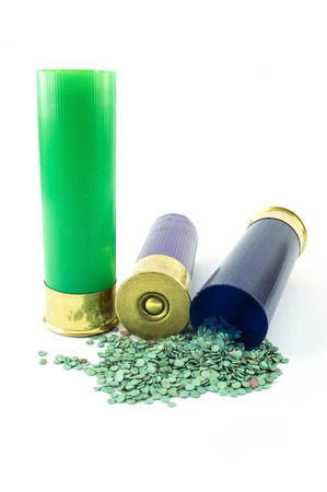 shotgun cartridge with gunpowder isolated on white