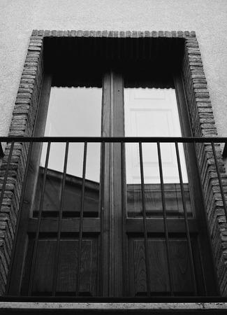 rustic window with iron railing
