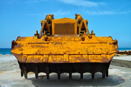 bulldozer front view under summer sky